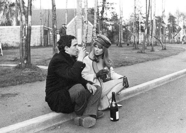 François Truffaut and Julie Christie enjoying a glass of champagne at Edgcumbe Park after a day's filming on the set of Fahrenheit 451 in 1966.